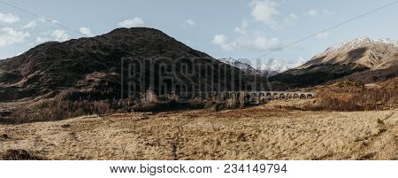 Panoramic View Of Glenfinnan Viaduct, Glenfinnan, Scotland, On A Sunny Spring Day.