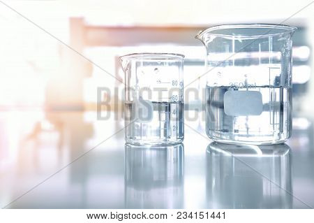 Two Clear Glass Beaker Research Experiment With Clean Water In Chemical Science Laboratory Backgroun