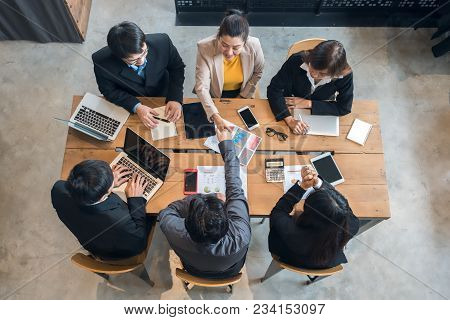 Businesswoman Are Shaking Hands With Businessman After Reaching Agreement On The Business Project By