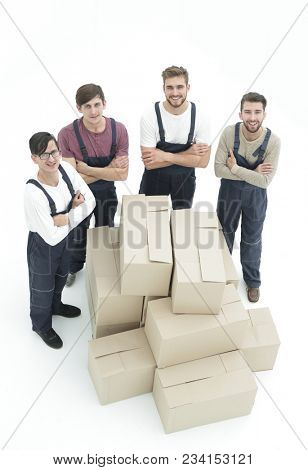Happy smiling movers carrying boxes, isolated on white backgroun