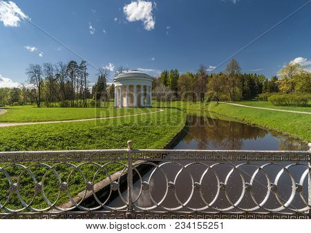 Classical Rotunda View With River And Grate Of The Bridge In Beautiful Spring Park