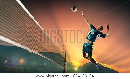 Professional Volley Player In Action At The Sunset