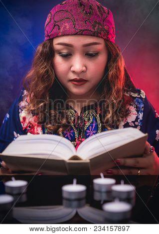 Female Seer Teller Doing Psychic Reading Book