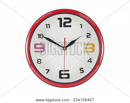 close up colorful round shaped wall clock isolated on white background, clock hands shown ten minutes to two o\'clock