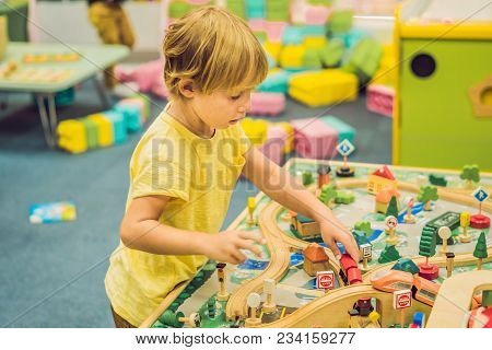 Children Play With Wooden Toy, Build Toy Railroad At Home Or Daycare. Toddler Boy Play With Crane, T