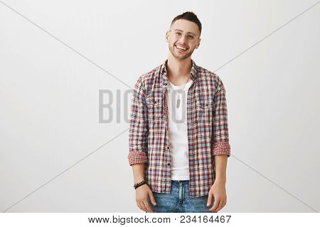 Cute Ordinary Caucasian Trendy Guy In Glasses Smiling Cheerfully And Gazing At Camera, Expressing Fr
