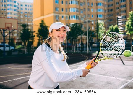 Woman Playing Tennis Outdoor, Hot Shot Ball. Practicing Tennis On The Tennis Court At Sunny Day, On