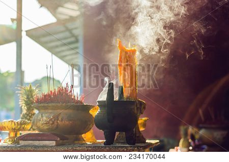 Incense Sticks On Joss Stick Pot Are Burning And Smoke Use For Pay Respect To The Buddha, Respect To