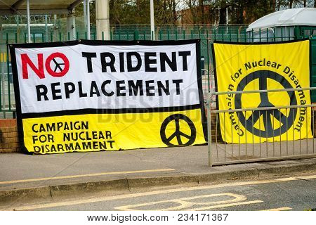 Aldermaston, United Kingdom, 1st April 2018:- Cnd Peace Banners By The Main Gate To The Awe Where Br