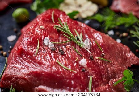 Flat Lay Of Raw Beefsteak With Tomatoes, Garlic, Hot Pepper, Dill, Parsley, Rosemary And Spicies On