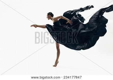 Modern Ballet Dancer Exercising Isolated In Full Body On White Studio Background. Ballerina Or Moder