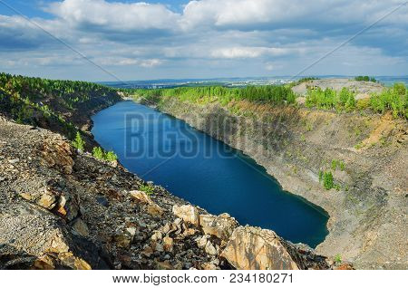 Dinas An Abandoned Quarry Filled With Water. Russia, Sverdlovsk Region, Pervouralsk City