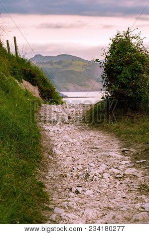 A Rustique Stoney Footpath Leading To Farway Seashore