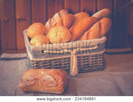 Fresh Baked Wheat Bread In Wicker Basket