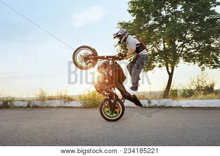 Ivano-frankivsk, Ukraine - 28 August 2015 : Extreme Stunt Driver Is Jumping On His Sport Motorcycle