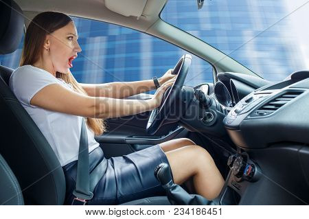 Young Frightened Driver Woman Squealing Brakes Avoiding An Accident