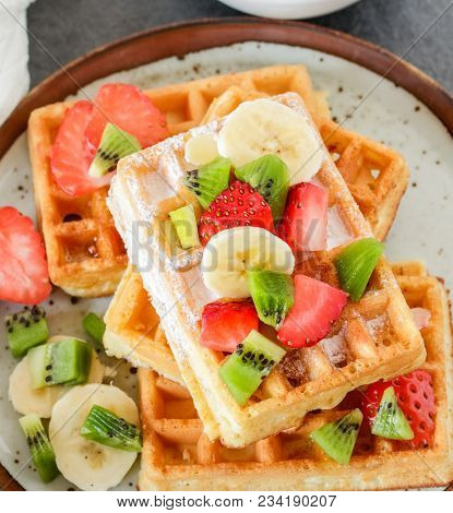 Homemade breakfast with waffles and fruits