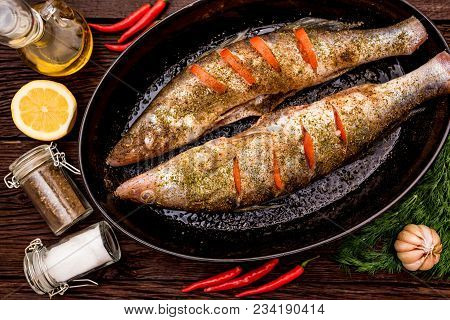 Zander Or Pike-perch Fillets On A Frying Pan With Spices, Tomato And Lemon. Healthy Diet Concept