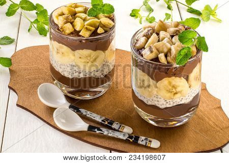 Chia Pudding With Chocolate And Banana On White Wooden Background. Cleansing, Diet, Healthy Food, Fi