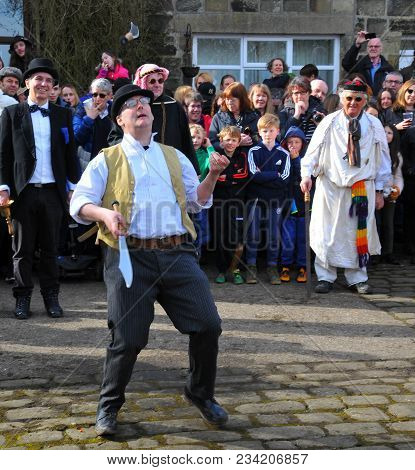 Heptonstall, Uk - March 20 2018: An Actor Juggling Knives In The Traditional Good Friday Pace Egg Pl