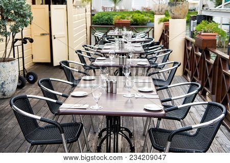 Terrace With Tables, Chairs And Cutlery In Philipsburg, Sint Maarten. Restaurant Open Air. Eating An