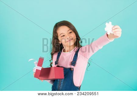 New Year, Christmas, Xmas, Eve, Holidays Celebration. Little Girl Smile With Snowflake From Gift Box