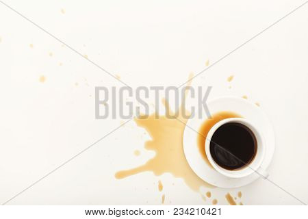 Cup Of Espresso And Coffee Spilt On White Isolated Background, Top View. Mockup For Grunge Advertise