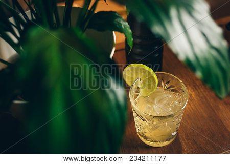 Summer Tropical Cocktail - Mai Tai Cocktail. Summer Beach Cocktail Concept. Tropical Leaves On Backg