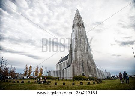 Reykjavik, Iceland - October 12, 2017: Hallgrimskirkja Church And People On Cloudy Sky. Christianity