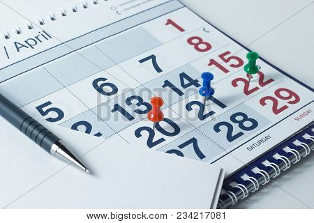 Wall Calendar And Pen, Important Days Are Marked With Knops