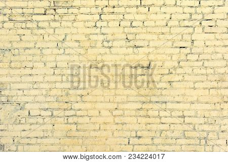 Yellow Brick Wall From The Unseen Rows. Light Blank Background. Texture Of Masonry.