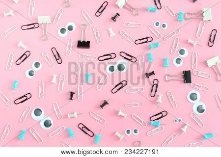 Funny Face From Clips And Puppet Eyes On A Pink Background. The Clerical Accessories Are Chaotically
