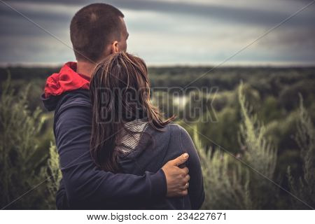 Young Couple Man Woman Together Embracing Looking Hope Into The Distance Concept Love Hope Togethern