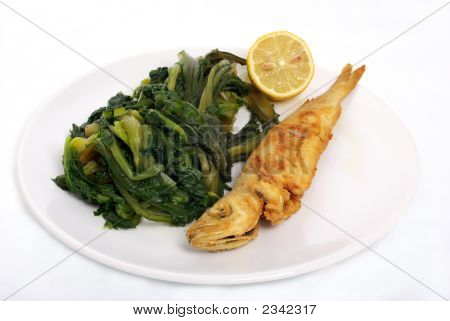Fried Fish And Vegetables In White Dish
