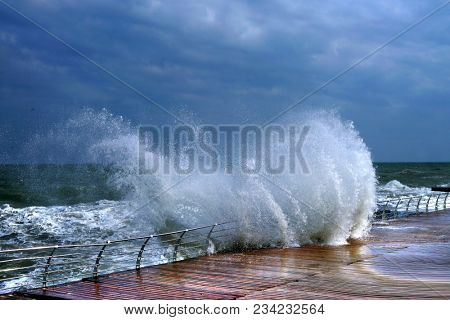 Huge breaking stormy wave. Big wave. The big wave is breaking about the shore