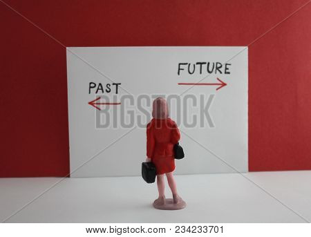 Back Arrow Past And Forward Arrow Future With Miniature Woman. Past Or Future Concept.