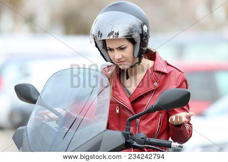Angry Biker On A Broken Down Motorbike On The Street