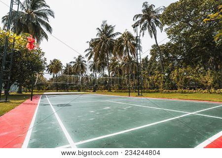 Wide-angle Side View Of The Badminton Court Located In Luxury Resort In The Maldives: Red And Green