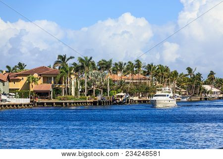 A Nice Yacht Passing Fort Lauderdale Mansion On The Intracoastal Waterway