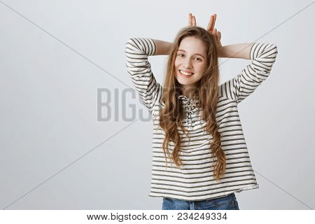 Cute Like Bunny. Portrait Of Emotive Good-looking Young Girlfriend Smiling Broadly, Standing In Casu
