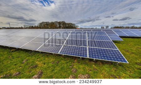 Solar Energy Panels Clean Energy Background In Meadow On German Countryside
