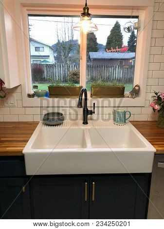 Amazing Farmhouse Sink Oversized With A Large Window Above It At A House Remodel And Renovation In O
