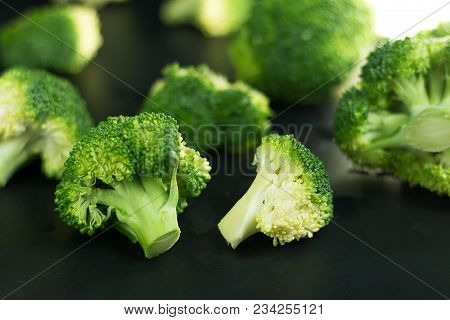Fresh Broccoli On Black Background.