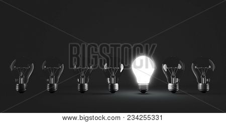 Light Bulb Row with One Illuminated Bulb with Dark Background. Individuality concept. 3D Illustration.
