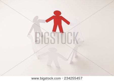 Closed Joining Of Six Paper Figure With Red One In Hand Down Posture On Bright White Background. In