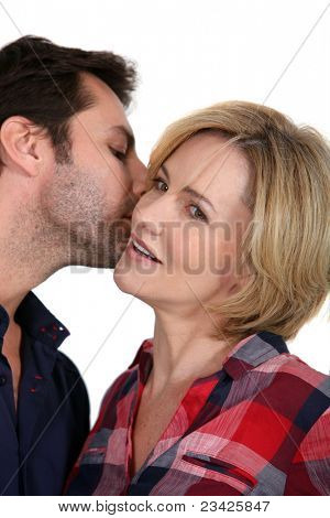 Man whispering in a woman's ear