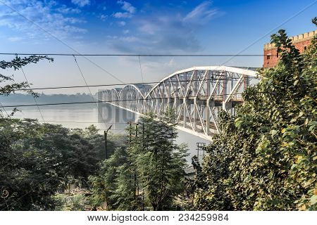 It is one of the major bridges on the Ganges river.  As the bridge is near Rajghat, it is also locally known as Rajghat bridge. Malviya Bridge is between Kashi, Varanasi and Mughal Sarai poster