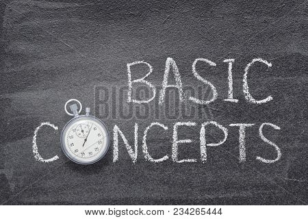 Basic Concepts Phrase Handwritten On Chalkboard With Vintage Precise Stopwatch Used Instead Of O