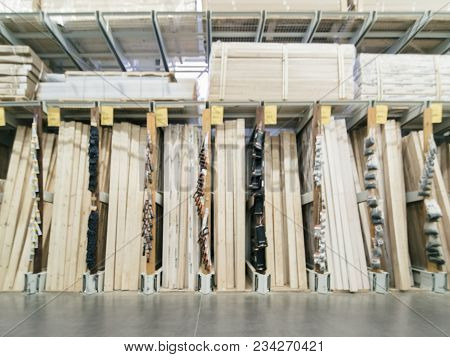 Abstract Blurred Hardware Store Shelves With Wooden Boards As Background