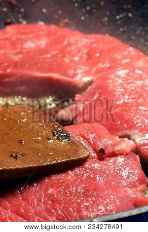 Raw Sirloin Beef Steaks On Frying Pan. Vertical Close Up Image.
